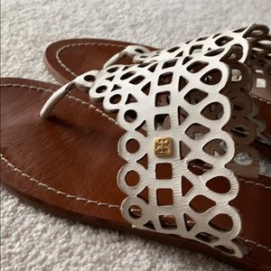 Tory Burch leather sandals with gold accent.